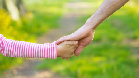 Photo pour A child with his father goes by the hand. Selective focus. nature. - image libre de droit