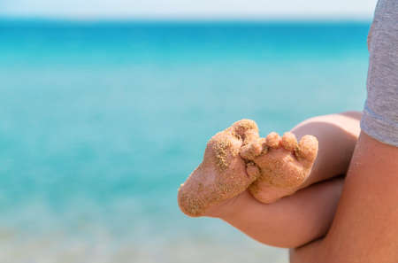 Photo for Baby feet on the background of the sea. Selective focus. People. - Royalty Free Image