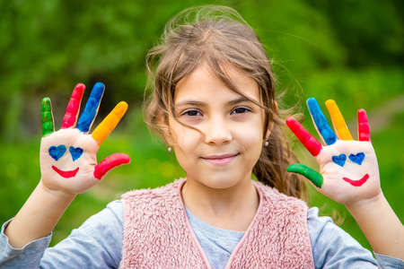 Photo for Smile on the hands of a child drawing. Selective focus. Kid. - Royalty Free Image