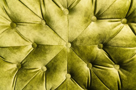 Photo pour Velor lime surface of sofa close-up. Training equipment-velor mats tightened with buttons. Yellow chesterfield style quilted upholstery background - image libre de droit