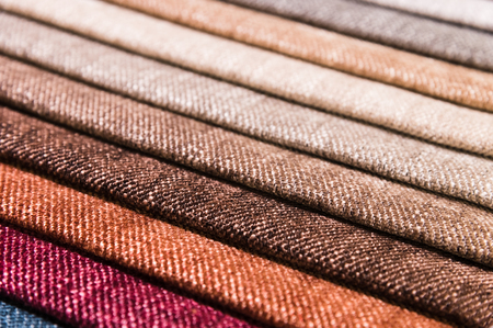 Photo pour Close-up diagonal lines of textile upholstery in samples to select the color and fabric of the furniture. Abstract multicolored background - image libre de droit