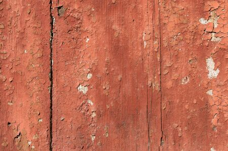 Foto de Old and peeling paint Over time, the red paint peeled off from the old boards and the wood texture cracked. Vintage Abstract Grunge Background - Imagen libre de derechos