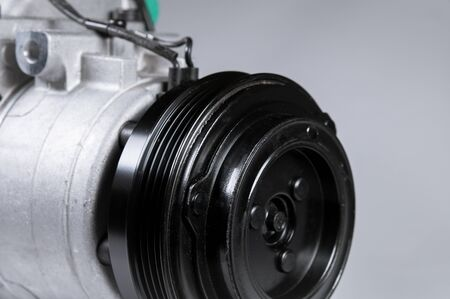 Photo for Close-up New car air conditioning compressor on grey background. - Royalty Free Image