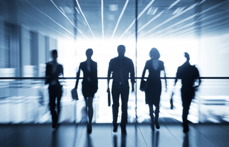 Photo pour Several silhouettes of businesspeople interacting office background  - image libre de droit