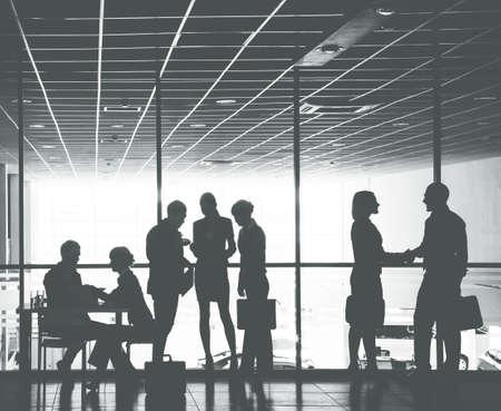 Photo pour Group ofl silhouettes of businesspeople comunications background business center - image libre de droit