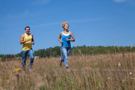 Photo for beautiful middle-aged people jogging in nature - Royalty Free Image