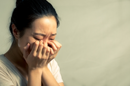 Portrait of young woman crying desperately, with fashion tone and background