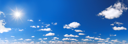 background from blue sky with white clouds. summer landscape panorama. panoramic view