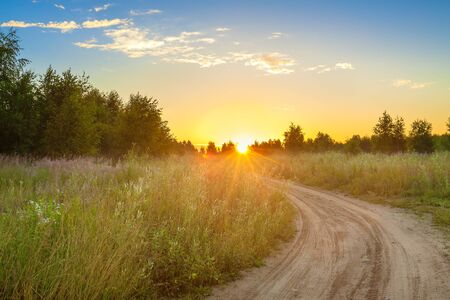 Photo pour amazing summer rural landscape with sunrise, road and forest . scenery spring scene view  - image libre de droit