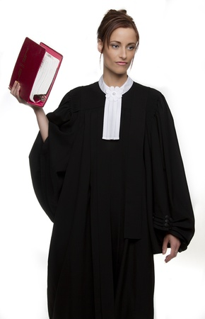 Women dress as a canadian attorney, holding a red book of law