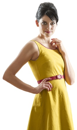 Young woman with bright yellow retro style fashion dress