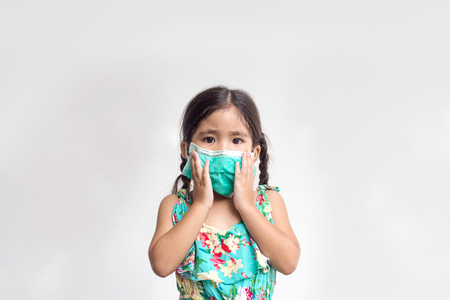 asian girl close up her mouth and nose with hygine mask for protectpolution