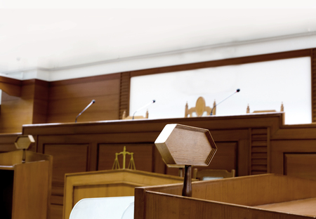 focus wood tag on courtroom attastor talking to magistrate in court. The law adjustment concept