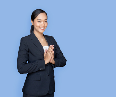 Photo for asian lady with business uniform suite in greeting action call Sawasdee in Thai traditional greeting as Hello on isolated background (Include clipping path) - Royalty Free Image
