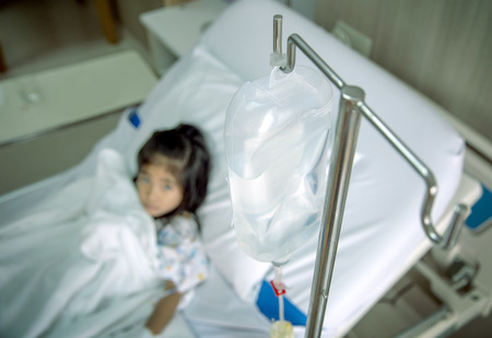 clinic heal kid Fluids Intravenous to blood vein in hosital room. Virus flue epidemic situation medicine healthy concept.