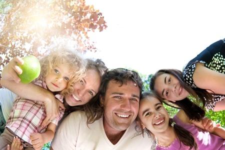 Happy family having fun in summer park