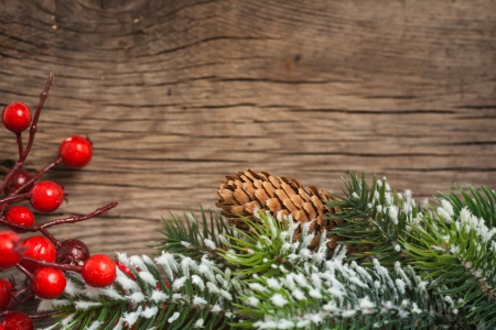 Border from branch of Christmas tree on wood