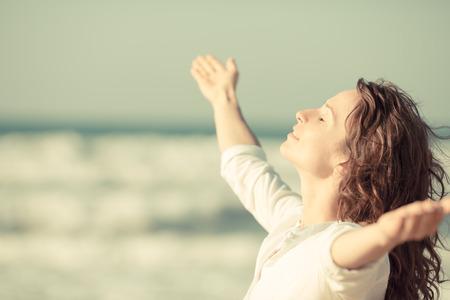 Beautiful woman enjoying life at the beach.