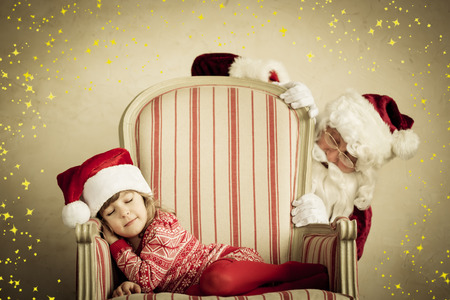 Santa Claus and sleeping child. Children dream. Christmas holiday concept. Xmas miracle