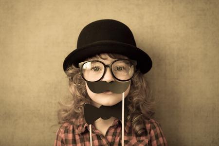 Happy hipster kid in studio
