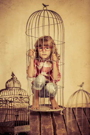 Photo for Sad child in steel cage. Human rights concept - Royalty Free Image