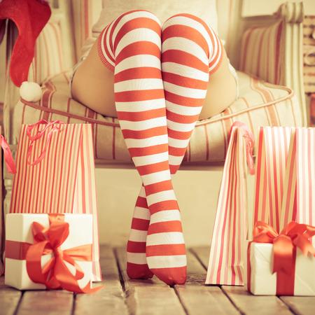 Foto de Sexy woman legs. Christmas concept - Imagen libre de derechos
