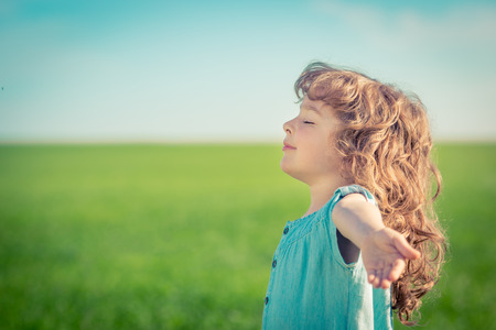 Photo for Happy child in spring field relax outdoors - Royalty Free Image