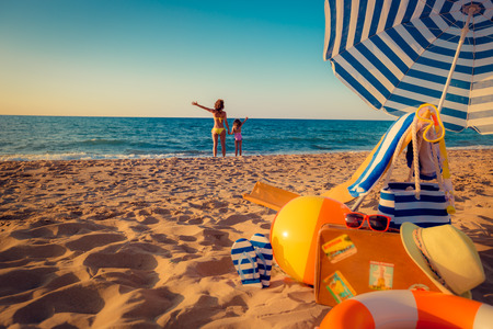 Photo pour Happy family on the beach. Summer vacation concept - image libre de droit