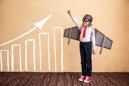 Foto de Portrait of young businessman with toy paper wings. Success, creative and startup concept. Copy space for your text - Imagen libre de derechos