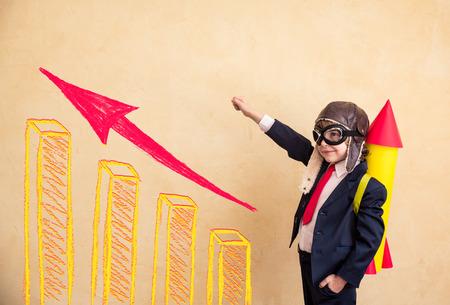 Foto de Portrait of young businessman with paper rocket. Success, creative and startup concept. Copy space for your text - Imagen libre de derechos
