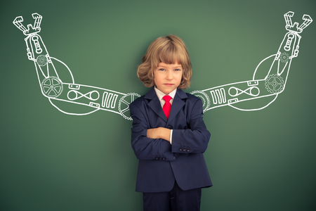 Photo for Kid with drawn robot hands against blackboard. Schoolchild in class - Royalty Free Image