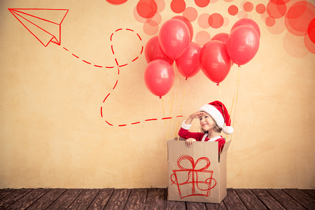 Child playing at home. Christmas gift. Xmas holiday concept