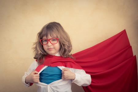 Foto de Portrait of young superhero kid businessman in office. Success, creative and innovation concept - Imagen libre de derechos