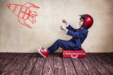 Photo pour Portrait of child businessman with suitcase. Start up business concept - image libre de droit