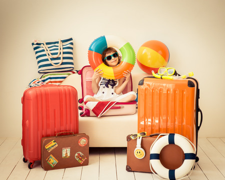 Photo pour Happy child ready for a summer vacation. Kid having fun at home - image libre de droit