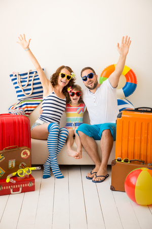 Foto per Happy family ready for a summer vacation. Father, mother and child having fun at home - Immagine Royalty Free