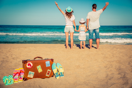 Photo pour Happy family having fun on the beach. Summer vacation and travel concept - image libre de droit