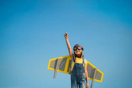 Photo for Kid with jet pack pretend to be superhero. Child playing in summer outdoors. Success, leader and winner concept - Royalty Free Image