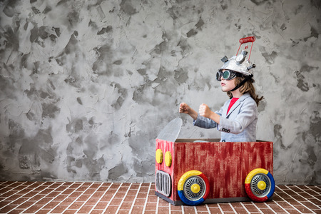 Photo pour Portrait of young child pretend to be businessman. Kid with toy virtual reality headset in modern loft office. Success, creative and innovation technology concept. Copy space for your text - image libre de droit