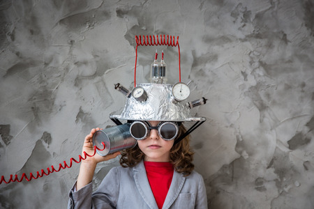 Photo pour Kid with toy virtual reality headset. Child playing at home. Imagination, creative and innovation technology concept - image libre de droit