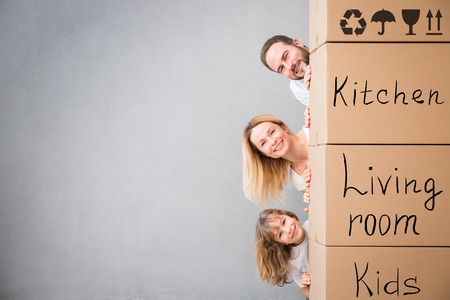 Photo for Happy family playing into new home. - Royalty Free Image