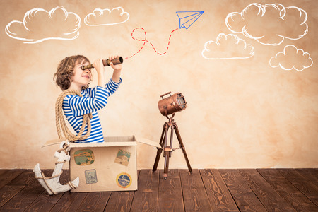 Photo for Child pretend to be sailor. Kid having fun at home. Summer vacation and travel concept - Royalty Free Image