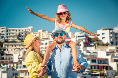 Photo pour Happy family travelling. People having fun in old european town. Summer holiday and vacation concept - image libre de droit