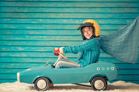 Photo pour Happy child playing at home. Funny kid on Christmas eve. Xmas winter holiday concept - image libre de droit