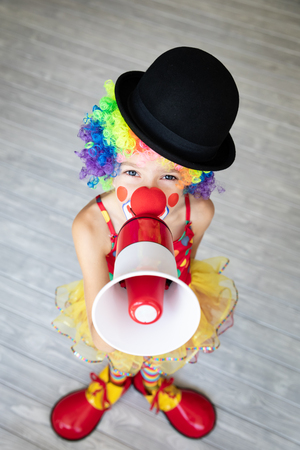 Foto de Funny kid clown. Happy child playing at home. 1 April Fool's day concept - Imagen libre de derechos