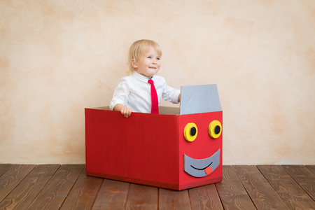 Photo for Happy child pretend to be businessmen. Funny kid playing at home. Education, start up and business idea concept - Royalty Free Image