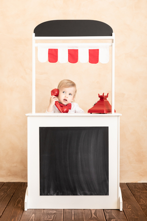 Photo for Happy child pretend to be businessmen. Funny kid speaking by phone. Education, start up and business idea concept - Royalty Free Image