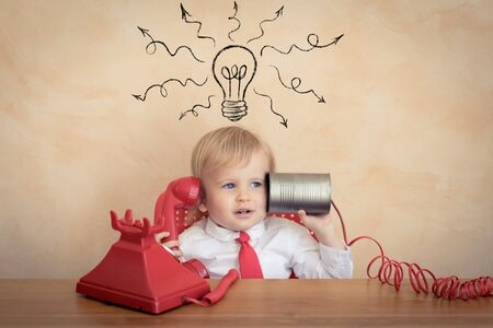 Photo pour Happy child pretend to be businessmen. Funny kid playing at home. Education, start up and business idea concept - image libre de droit