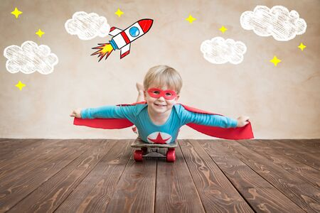 Photo for Portrait of super hero on the skateboard. Happy child playing at home. Superhero kid having fun. Success, creative and start up concept - Royalty Free Image