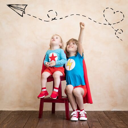 Photo for Superheroes children playing at home. - Royalty Free Image